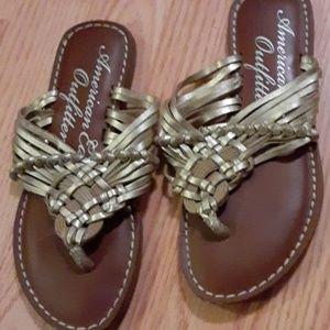 Gold woven thong sandals